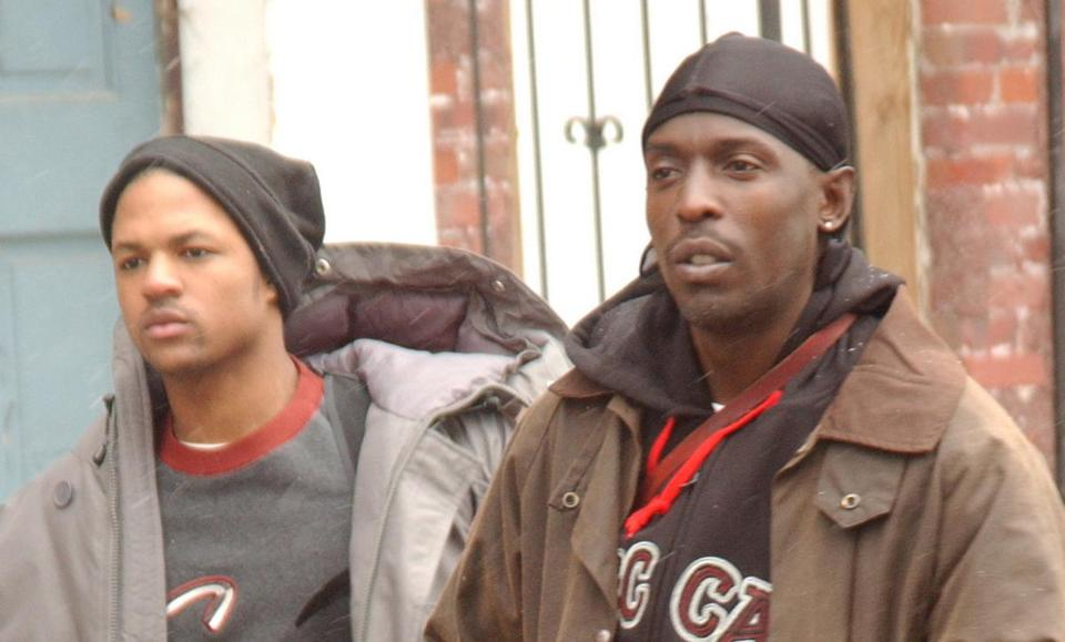 "Michael K. Williams, foreground, as Omar Little in the HBO series ""The Wire."""